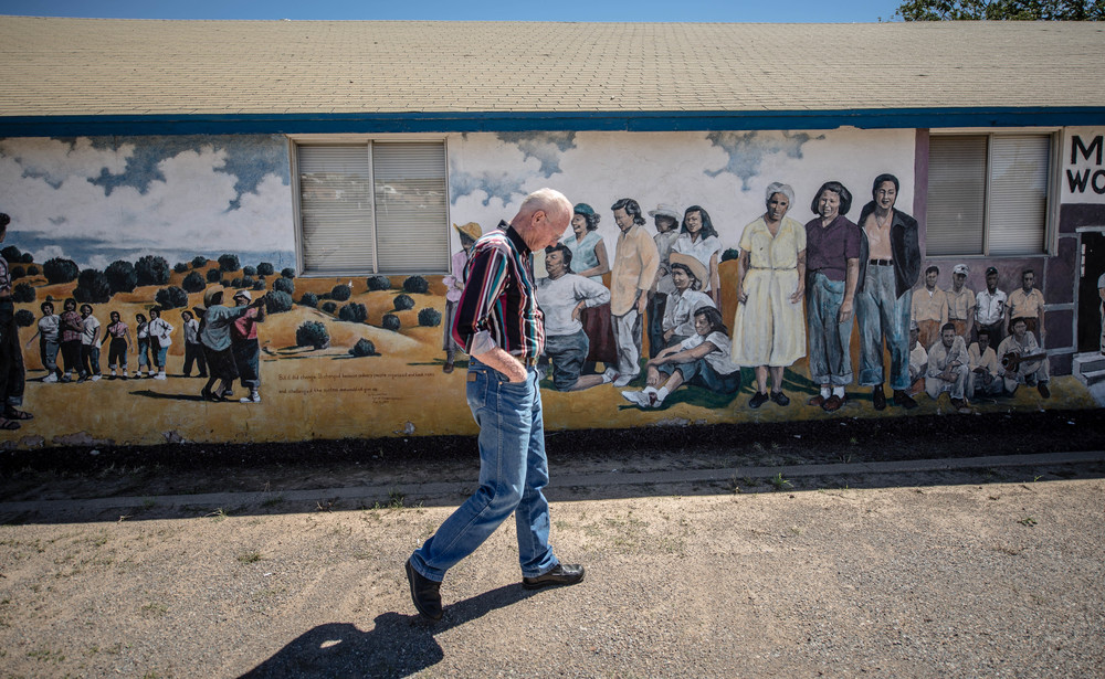 Terry Humble, 73, walks past the union hall in Bayard, which is covered inside and out with murals memorializing the Salt of the Earth strike, which won gains for Hispanic miners at the Empire Zinc Co. mine north of Bayard. (Roberto E. Rosales/Albuquerque Journal)
