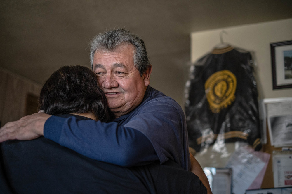 Ray Teran, a 40-year veteran of the Chino Mine, hugs Frances Gonzales, whose father was a longtime miner and union member. Teran was chairman of United Steelworkers Local 9424-3, which was decertified after a union election last month. (Roberto E. Rosales/Albuquerque Journal)