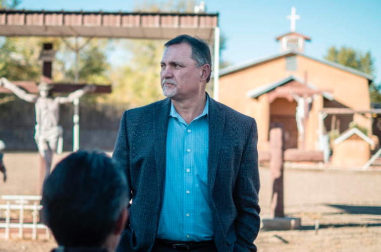 Jerome Padilla, president of the town of Atrisco board of trustees, stands in front of San Jose Church. Padilla and others want the church to be reserved for religious purposes.