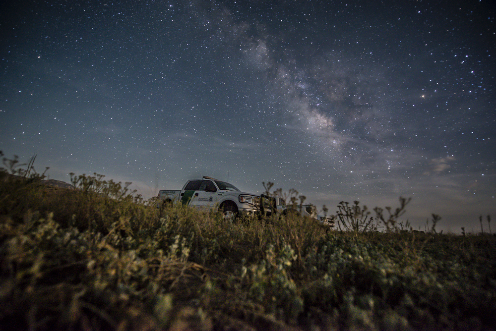 A Border Patrol unit parked under the Milky Way in southern New Mexico