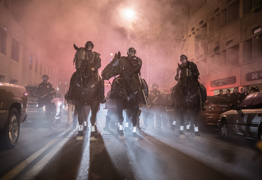 Mounted police get in position to remove protesters in Albuquerque.