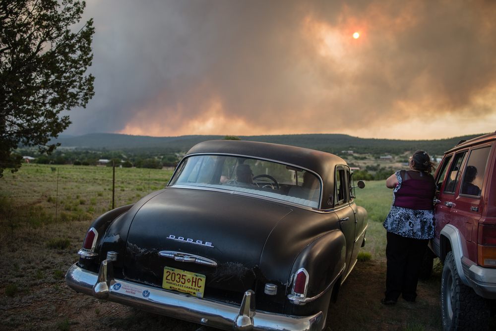 Resident of Chilili watch the Dog Head Fire approach