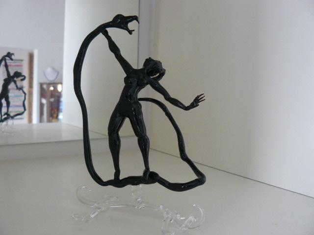 Lady fighting snake, black sculpture  € 99