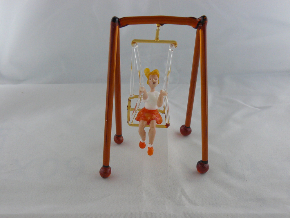 Girl on hammock chair, orange skirt, 2016