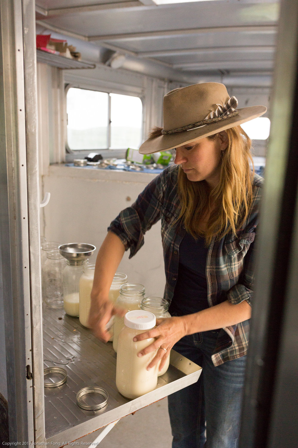 Doniga begins her day by packing raw cow's milk for their CSA deliveries. CSA, or Community Supported Agriculture, is a powerful connection between a farmer and their customers. It not only supports the Markegard's business, but also enables them to share a high quality product with the community and nurture families like theirs.