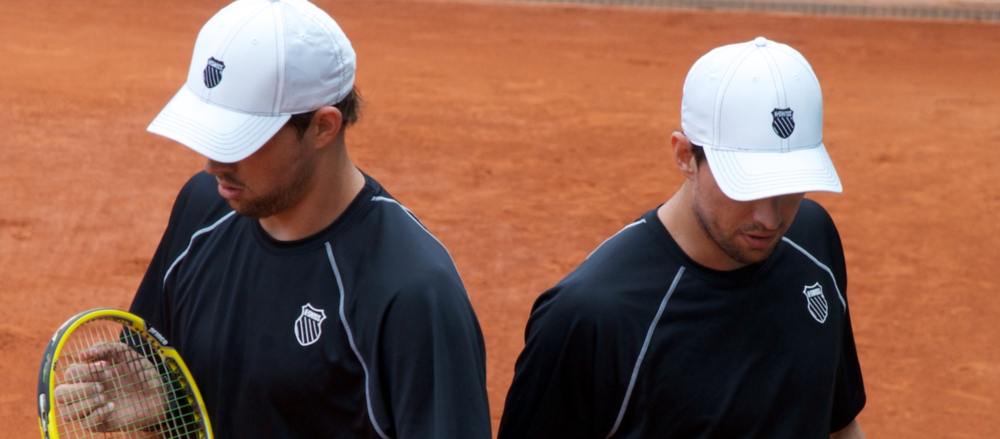 The Bryan Brothers confer.