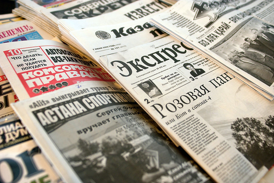 Russian and Kazakh language newspapers and magazines are displayed at a newsstand in Astana, Kazakhstan, on June 7, 2006.