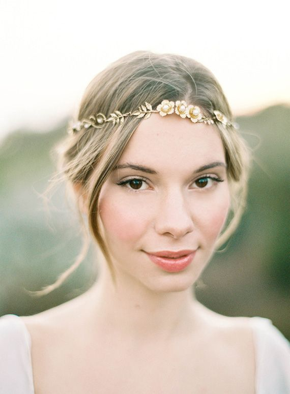 If you're going to rock a headpiece that goes across the forehead (sometimes referred to as a modern crown), we love the delicateness of this fantastic piece by Hushed Commotion.