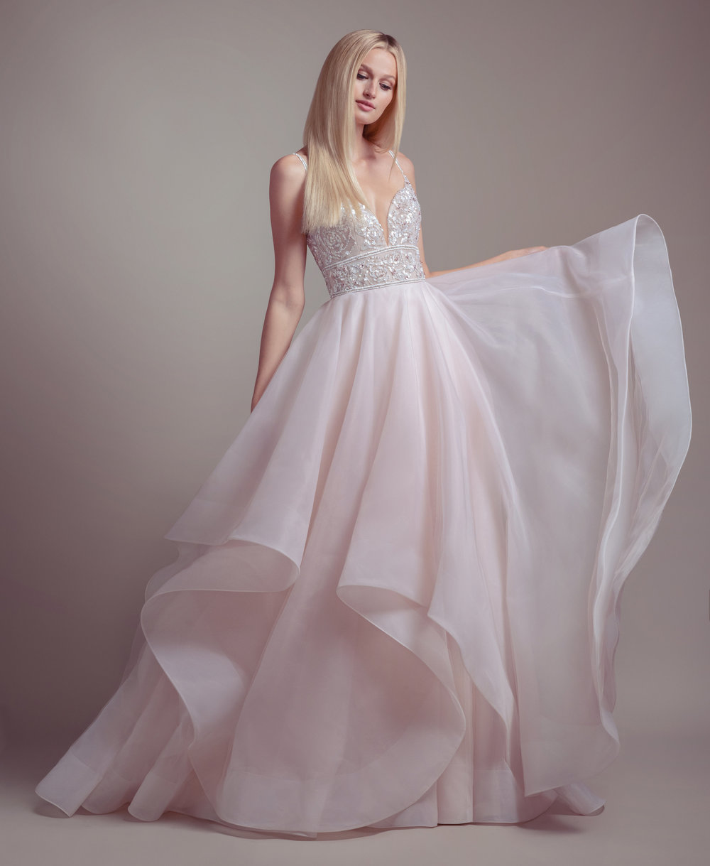You don't need rose colored glasses to love this blush colored wedding dress.