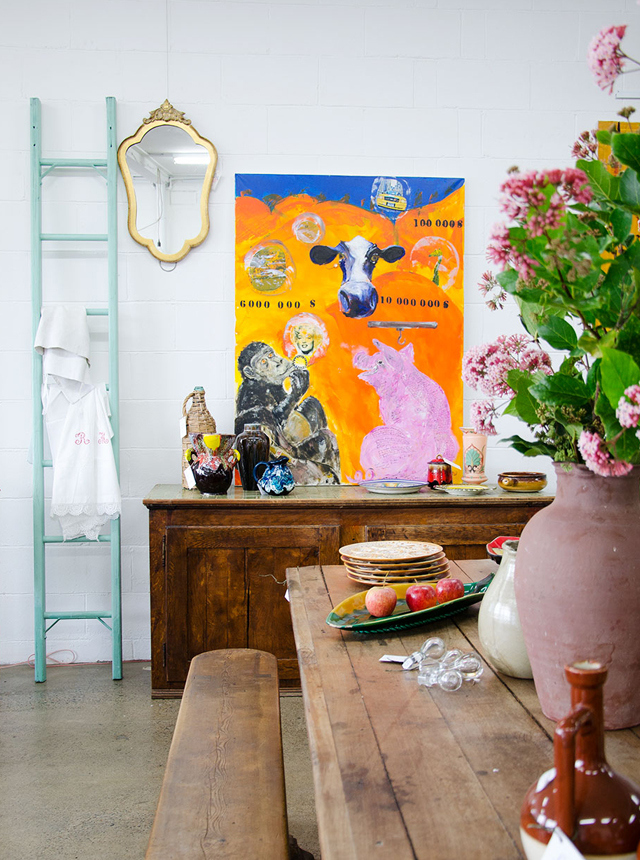 Alex 'le chat' Roynette painting + French oak farmer's table with matching bench seats. Photo: Ezra La Vin for Take Your Vitamins