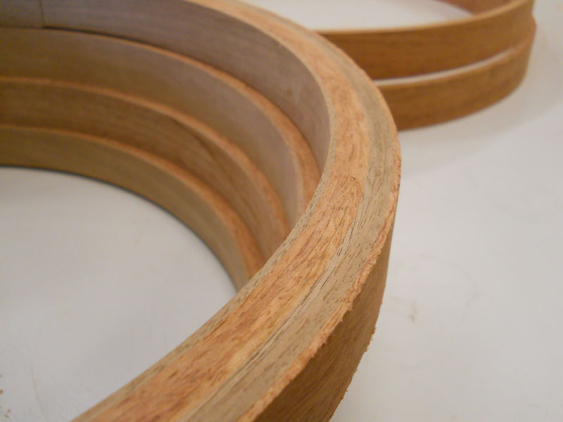 Bubinga and walnut hoops with beveled edge.