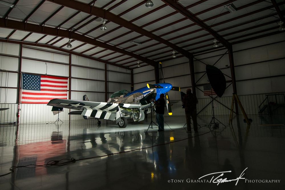 BTS image showing the (4) Westcott Spiderlite setup inside the hangar.