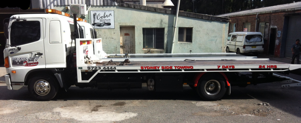 Two identical tow trucks, towing liverpool