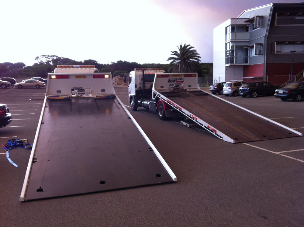 Preparing  trucks ready for towing golf carts around Sydney