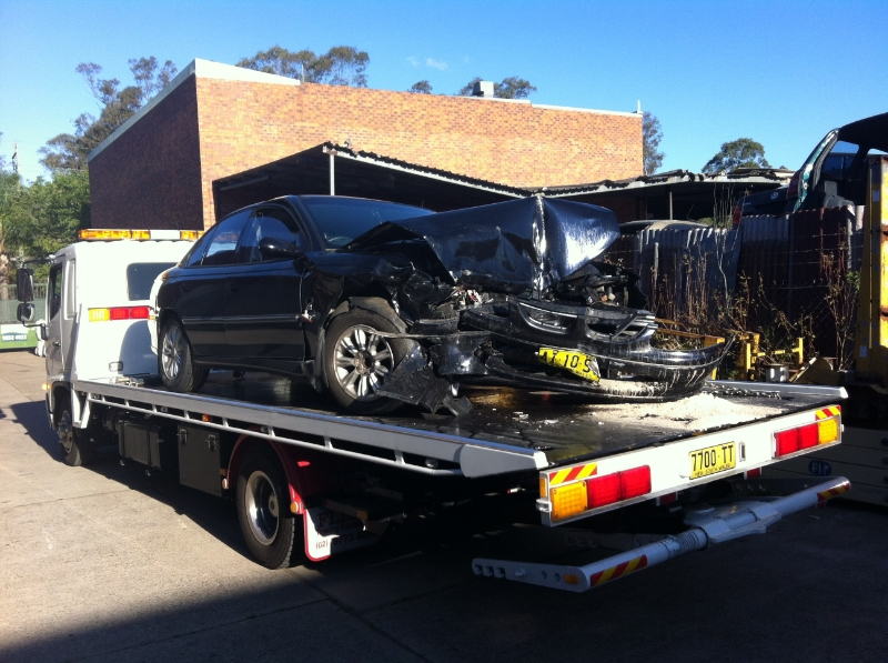 Car on the back of truck, towing sydney
