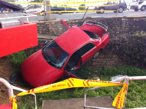 Car over wall, Sydney side towing was called out to help