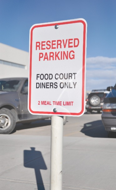 A parking sign was placed in the front spot in the mall parking lot to get mall-goers thinking about the food court even as they parked.