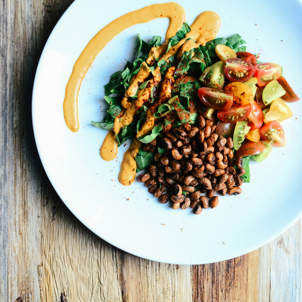Caribbean Jerk Roasted Black Eyed Peas + Baby Heirloom Tomato Spinach Salad topped with Tomato Cheesy Cashew Dressing | Seed Plant Water Grow