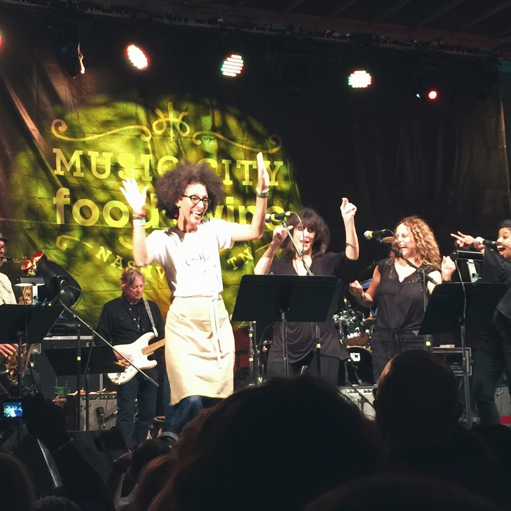 Carla Hall dancing on stage at Harvest Night