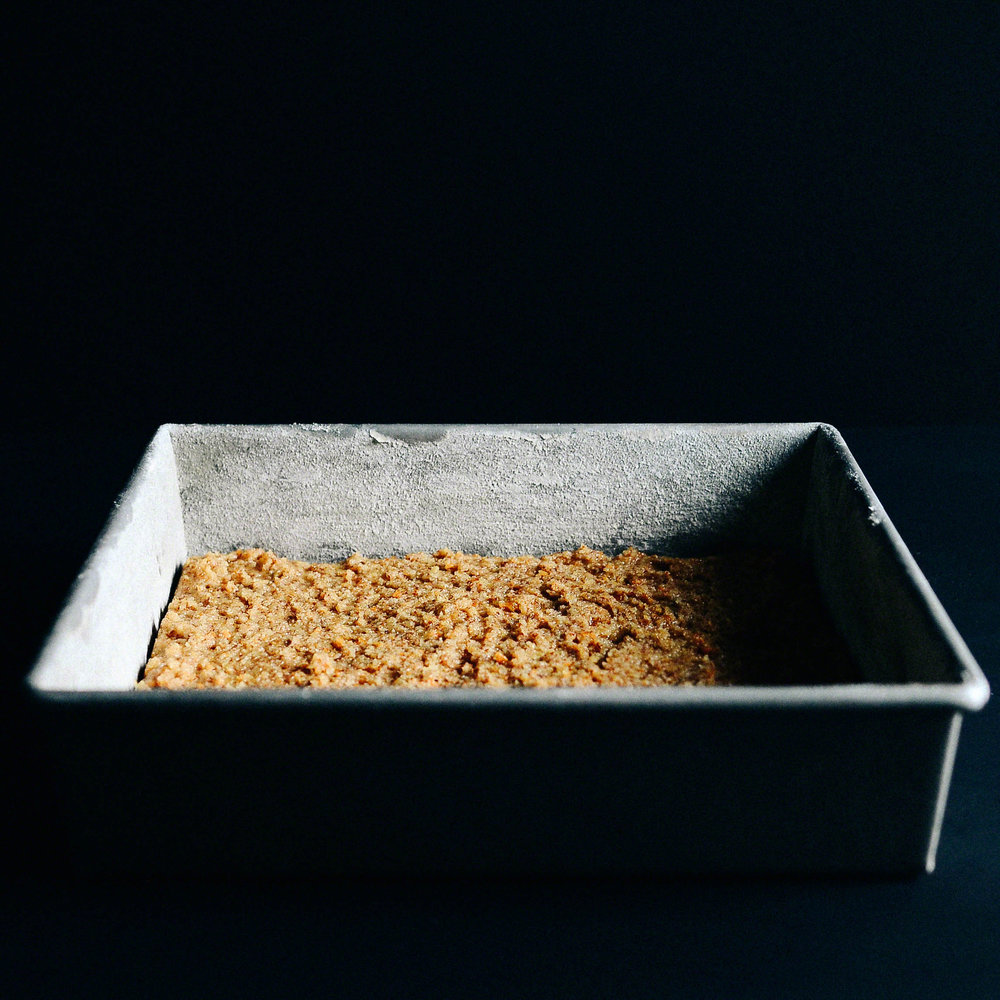 Whole Satsuma Almond Squares topped with Glaze, Toasted Coconut and Zest | Seed Plant Water Grow