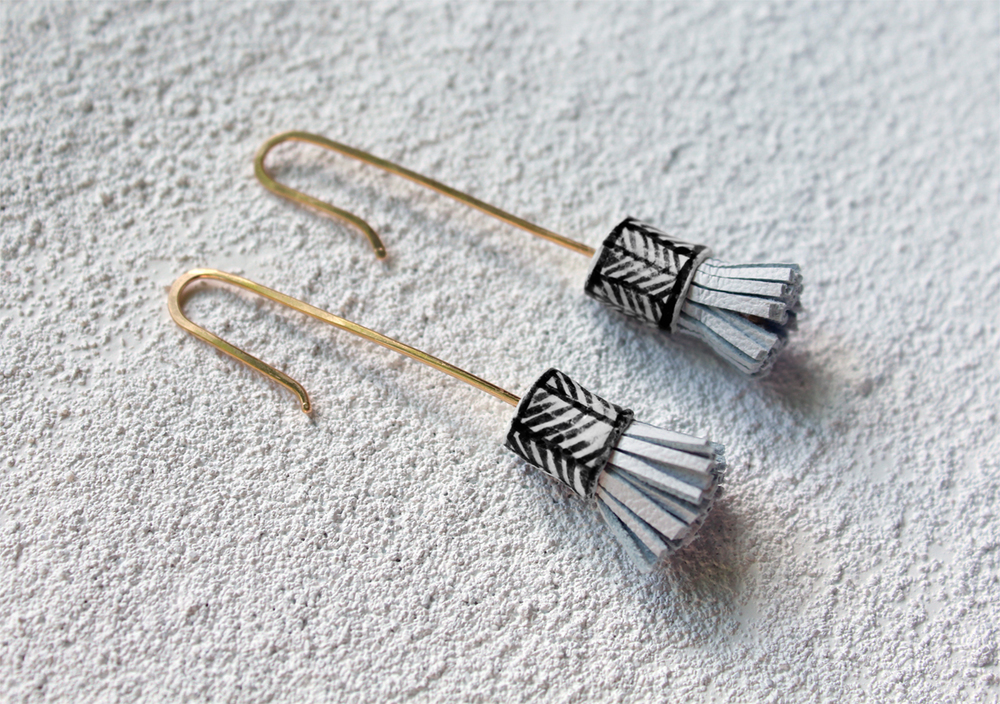 http://www.hechizolindo.com/earrings/little-drum-earring-white