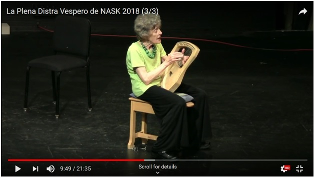 Sheila Devlin at the Esperanto North American Summer Course. To hear her sing and play, click  here  and go to minute 8:47.