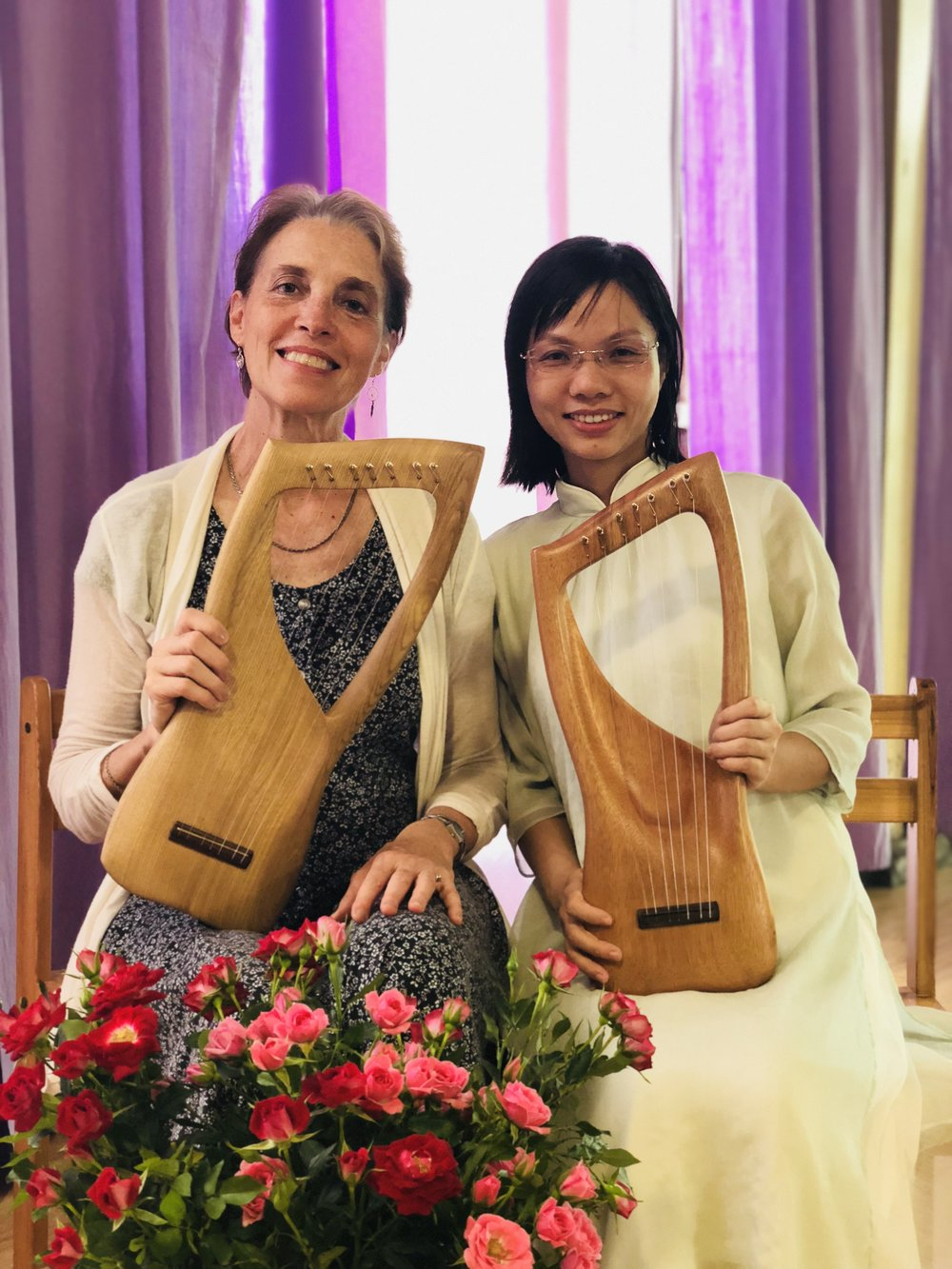 Sheila Johns and Vicky Deng with Angel Wing children's lyres