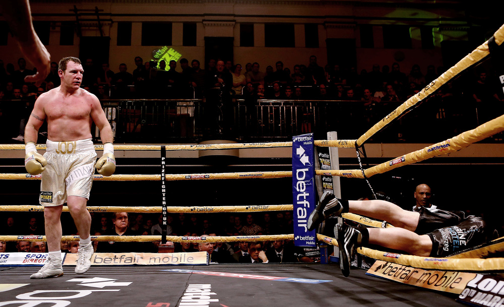 Martin Rogan knocks Albert Sosnowski through the ropes during the International Heavyweights III betfair Prize Fighter at York Hall, Bethnal Green, London