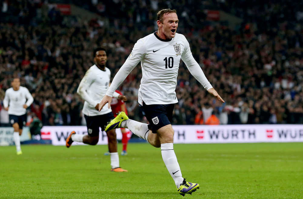 Wayne Rooney celebrates scoring their first goal during the FIFA 2014 World Cup Qualifying match against Poland at Wembley Stadium, London