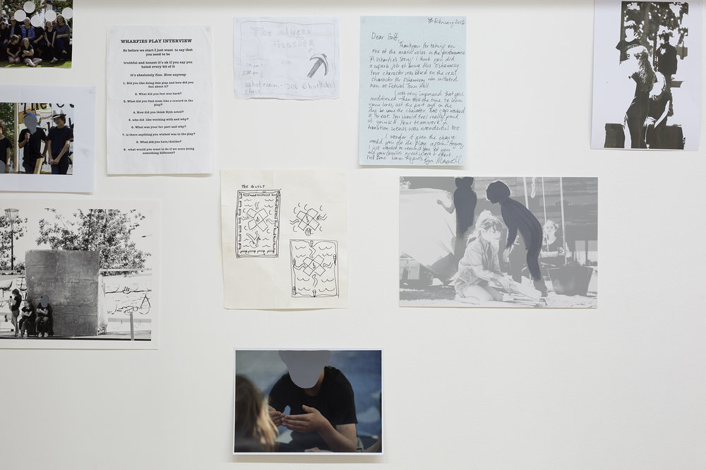 storyboard iteration 2017 , teaching and leaning ephemera from a 2015 performance arts curriculum, seven pine stud arches and frames, white corduroy, nails, screws, two wooden stools, archival images gifted from Jim and Tui Beggs, multiple imagery reproduced from photographs by Keelan O'Hehir, Christian Capurro and Kym Maxwell relate to the theatre production A Wharfie's Story performed by The Collingwood College Theatre Troupe (2015), as well aswatercolour drawings and lithograph prints, notebook digital reproductions, charcoal comments, bluetak, gold split pins, sticky tape All altered documentation, drawings, paintings, prints and sculptures by Kym Maxwell (2016-2017). Dimensions variable, ongoing installation instructions the fabric corduroy wallmust be 730 mm distance from the gallery wall, partly concealed with its height one third lower than the gallery wall.For storyboard poetics and pedagogic process Westspace Gallery. Image: Christian Capurro