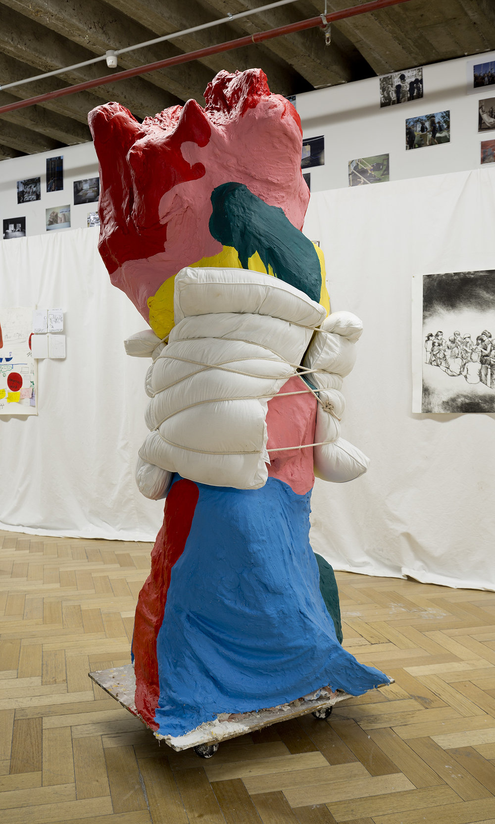 Education's blood with water viaduct and soft cell stitches , 2017, cardboard tubing, gauze from previous sculpture, backdrop material, plaster, house paint, clear Perspex single filing cabinet, curriculum documentation, rope, cardboard tubing, elastic, pillows,2050 X 600 X 450mm.Image: Christo Crocker