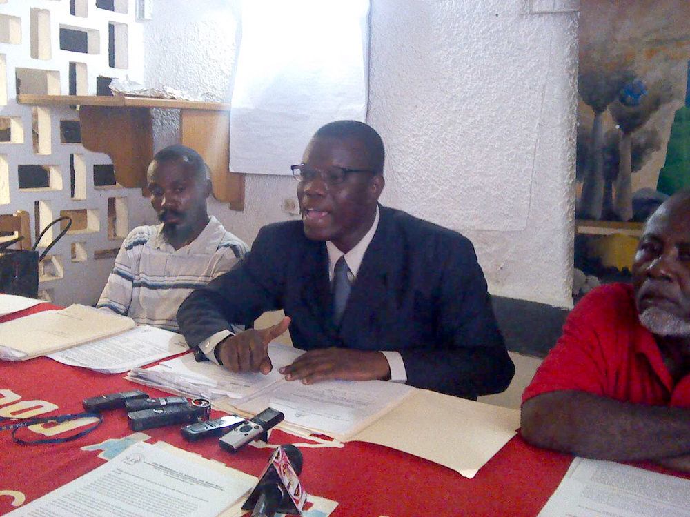 Attorney Patrice Florvilus speaks at a press conference denouncing threats made against him and other Haitian human rights defenders.