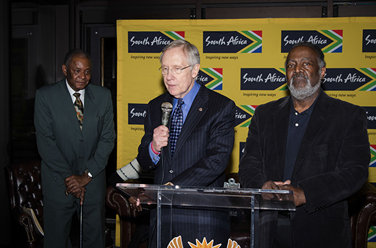 Senator Harry Reid speaks at the vigil held in memory of Nelson Mandela at the South African Embassy in DC.