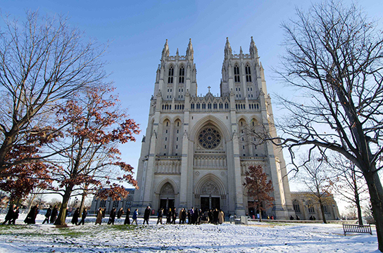 Guests line-up outside the National Cathedral in the early morning for the US National Memorial for Nelson Mandela