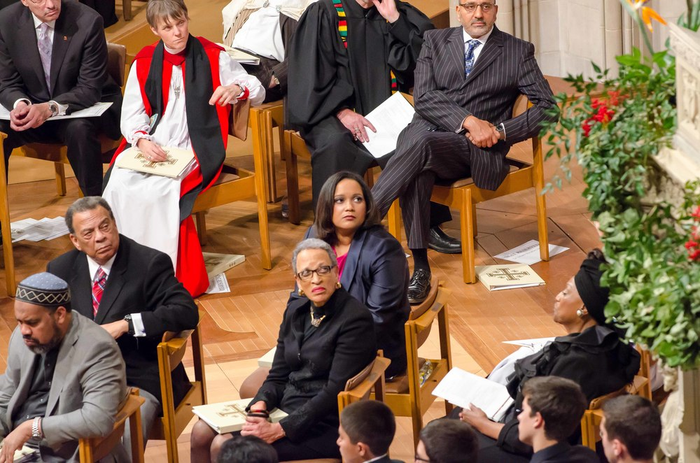 TransAfrica President Nicole Lee and board member Sylvia Hill listen as Dr. Boesak delivers the homily.
