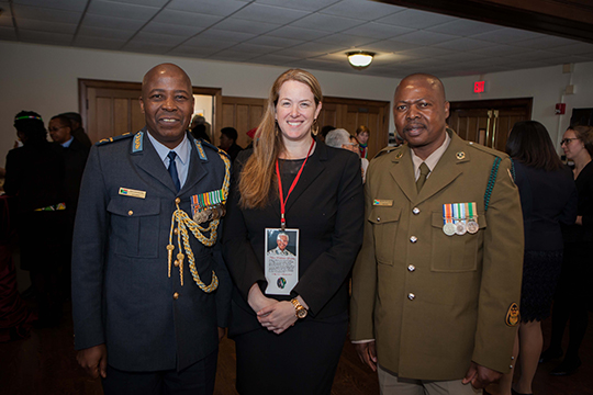 Brigadier General Phala, Melinda Miles and other military officer pose for a picture at the reception following Nelson Mandela's US National Memorial Service.
