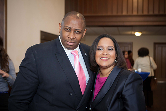 Reverend Dr. George Holmes and Nicole Lee pose for a picture at the reception following the Nelson Mandela memorial service in DC.