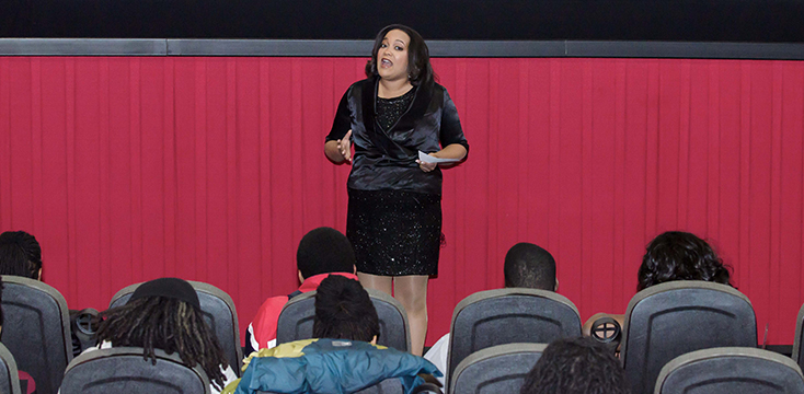 "TransAfrica President, Nicole Lee, addresses the theater filled with viewers for the screening of ""Mandela: Long Walk to Freedom"""