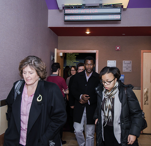 "Guests exit the theater after watching the movie ""Mandela: Long Walk to Freedom"""