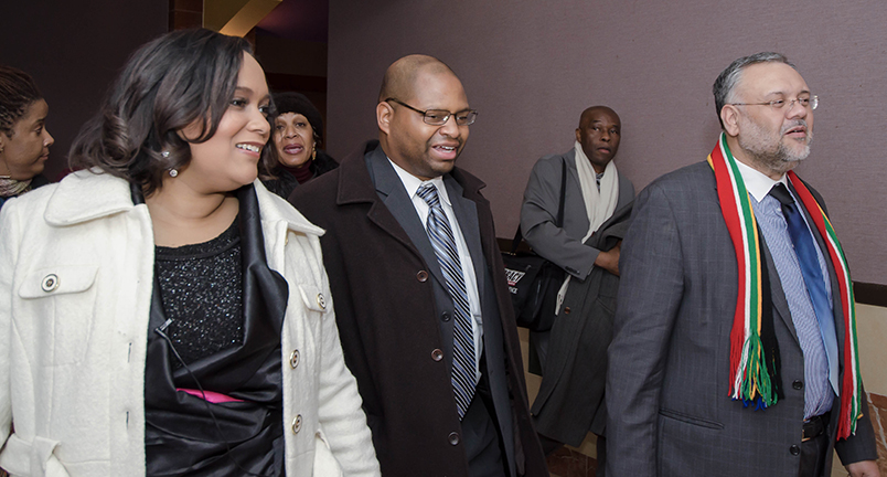 "TransAfrica President, Nicole Lee, husband Mark, and South African Ambassador, Ebrahim Rasool talk as they exit the theater after watching ""Mandela: Long Walk to Freedom"""