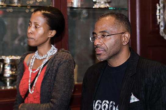 "Lloyd Anderson listens to Ambassador Ebrahim Rasool speak to the crowd at TransAfrica's film reception for ""Mandela: Long Walk to Freedom"" at Clyde's."