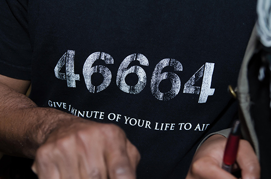 "Lloyd Anderson wore a shirt emblazoned with Nelson Mandela's prison number to the TransAfrica film screening of ""Mandela: Long Walk to Freedom"". The numbers have long since been a symbol of his sacrifices for change and was used for HIV/AIDS prevention campaigns."