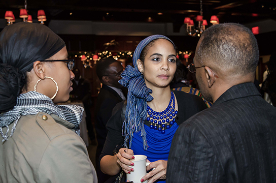 "Jalaika Khalil speaks with other guests at TransAfrica's film reception for ""Mandela: Long Walk to Freedom"" held at Gallery Place in DC."