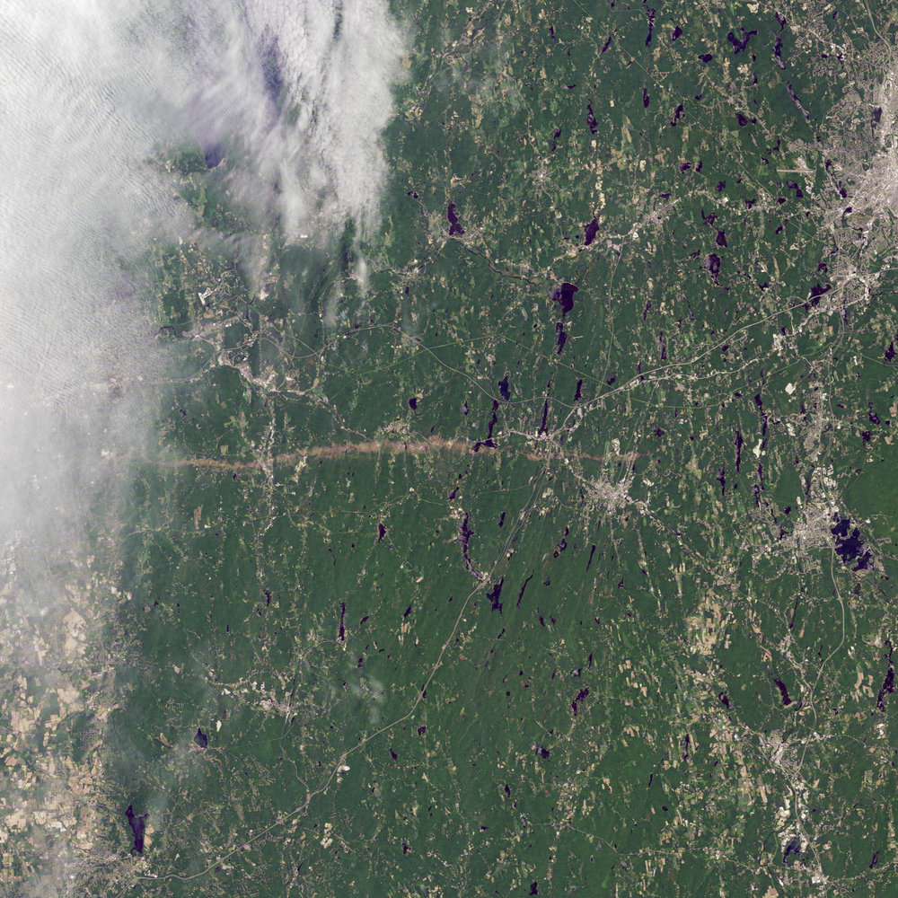 Satellite image of tornado track over western Massachusetts from NASA's Earth Observatory
