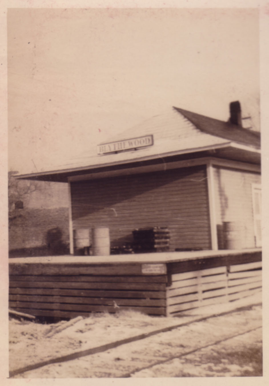 South end of depot.  Photo by Hudnalle McLean Sr.  Note platform and fire barrel.