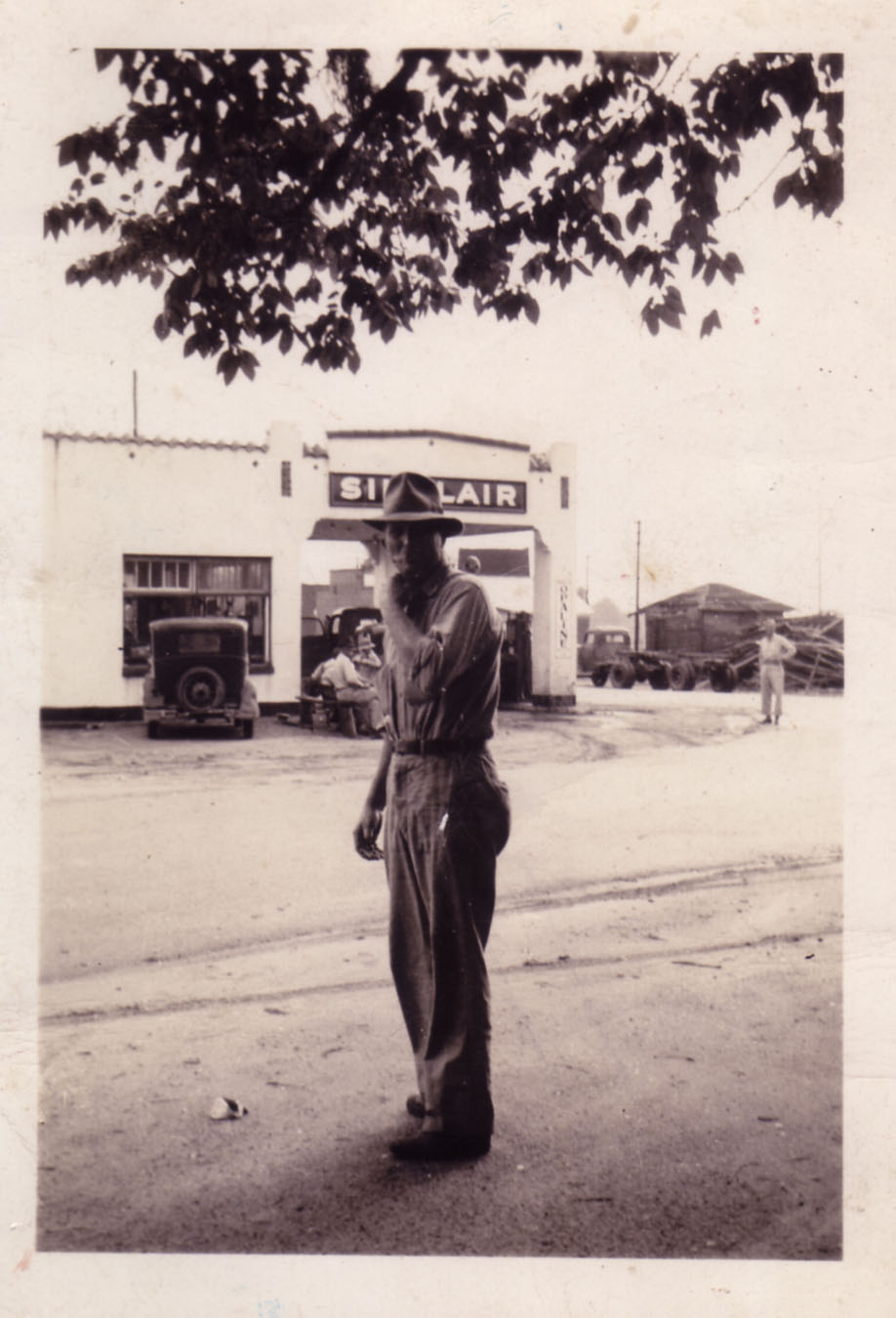 Earl Boney with old service station in background.  Photo courtesy of Frank Boney.