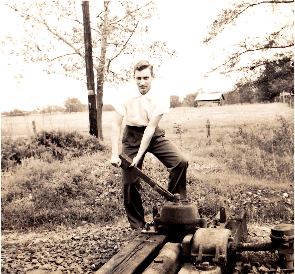 Harry Norton operating sidetrack switch.  Photo taken by Hudnalle McLean Sr. in 1959.