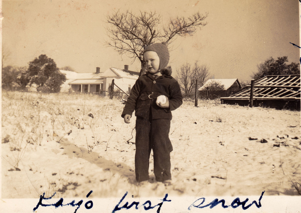 Kay Wilson Lydon first snow. Note old greenhouse in background.  Photo taken in early 1940's and provided by Kay Lydon.