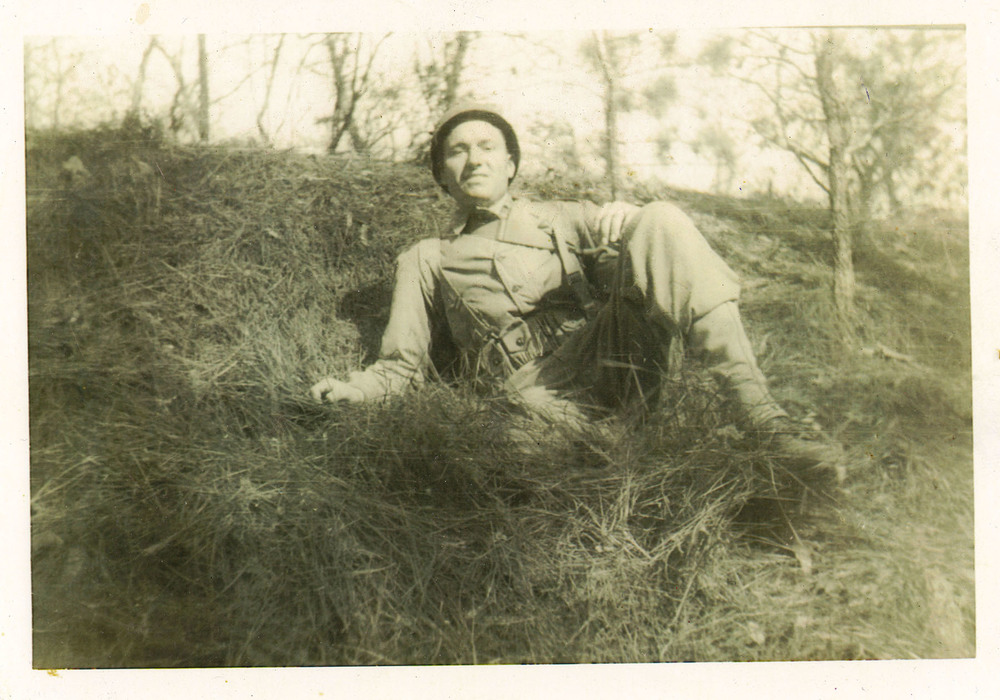 Sargent Charles Branham in Normandy France.  Received the Purple Heart for injuries he sustained in WWII.