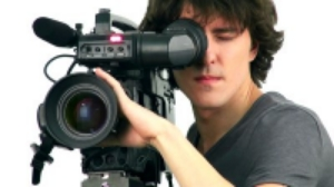 stock-footage-professional-cameraman-isolated-on-white-background.jpg
